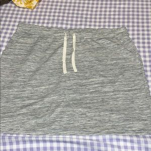 Sweatshirt material type skirt with pockets